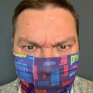 "Picture of Per wearing a face mask, with the famous ""RockYou passwords"" fabric design by professor Lorrie Cranor at CMU."